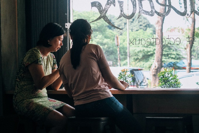 mother and daughter in restaurant