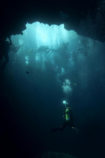 man dives underwater