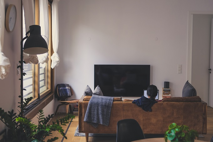 woman using laptop in her living room
